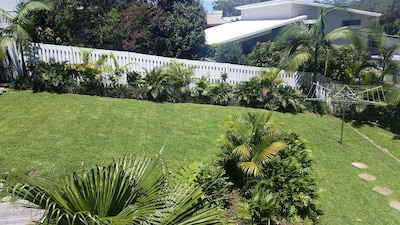 Back yard is completely secure, plenty of room for your pets to run around