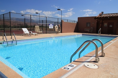 The pool and hot-tub area. Tennis court in background