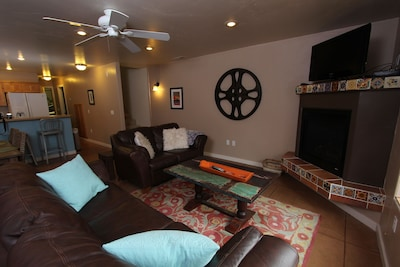 Living room with fireplace and plasma tv.