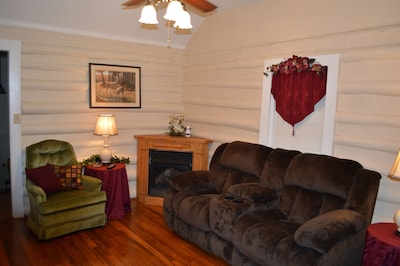 Living room with gas logs.