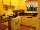 gas range, copper counters, well stocked kitchen