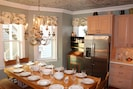 Custom Table Seats 14, beautiful tin ceiling, crown moulding & lovely chandelier