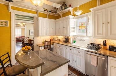 Kitchen with granite countertops and tons of supplies!