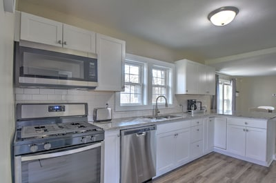 Large updated kitchen with full size stainless steel appliances and gorgeous cou