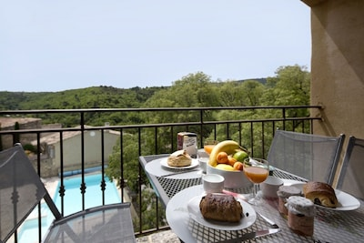 Your private balcony overlooking the pool and Luberon valley
