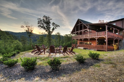 The cabin overlooking Mount LeConte has a FLAT backyard and sits atop a hill