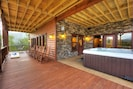 Lower deck with 8 person hot tub, swing,rockers & walk out to yard and fire pit