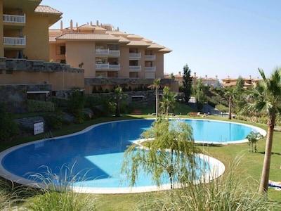 Luxury 2 bedroom ground floor apartment in El Higueron country club, pool WI FI