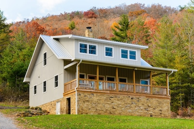 Modern yet classic home on the edge of 40 acres with open floorplan & huge porch