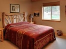 One of 3 bedrooms with queen-sized bed.