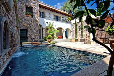 Serene courtyard, w/heated pool, outdoor grill and dining area
