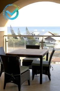 4 seat balcony deck for meals or work, then take a break on the Eagle Beach.