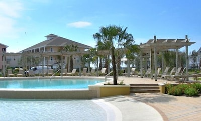 Gorgeous pool and hot tub with pavilion area and lush landscaping~Breathtaking!