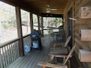 Covered side porch with gas grill.