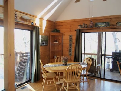 Dining opens to covered side porch with gas grill.
