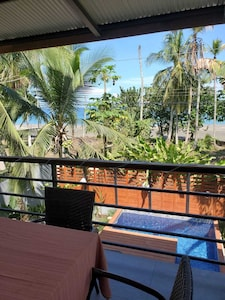 View of the private plunge pool on the first floor and the sea and beach beyond.