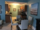 Kitchen with new stainless appliances. Stocked w/ other amenities for guest use.
