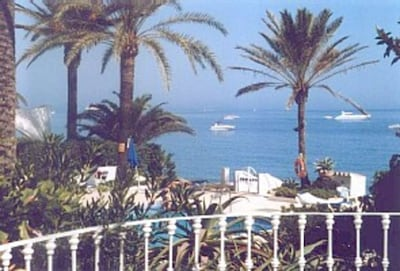View of pool and sea from lounge