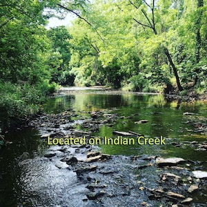 Located on beautiful Indian Creek in the backyard - with miles of trails.