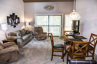 Spacious living room with large flat screen and slider to the back deck