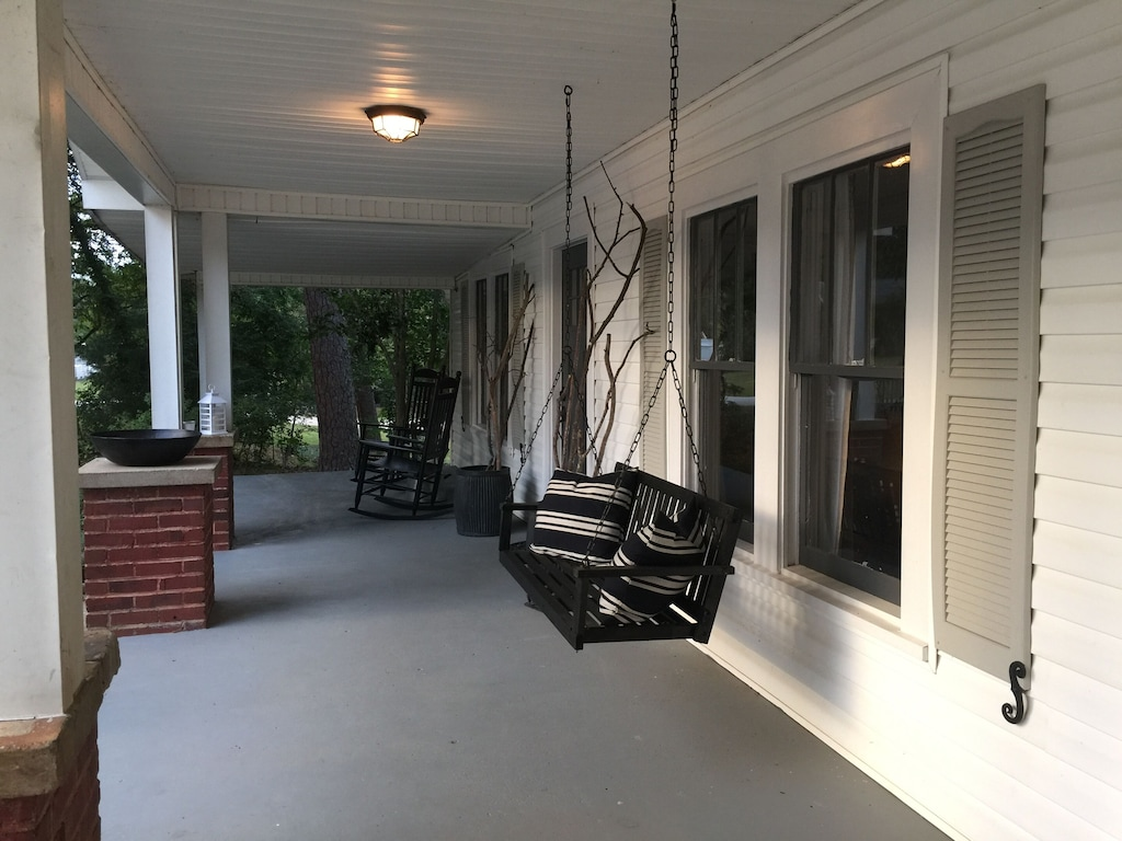 Front porch with rocking chairs and swing