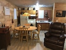 Charming kitchen with log dinning Table, cozy lighting..fully stocked