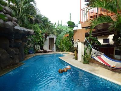 Pool and community kitchen/bar at Casa Bambora