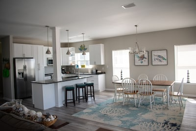 Open great room, dining and kitchen so everyone can enjoy family time together