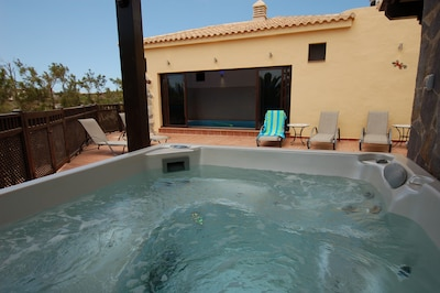 Relax in the hot tub (clothes optional).  Extra large pool towels supplied.