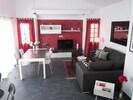 Wohnzimmer mit Ausgang zur Innenterrasse