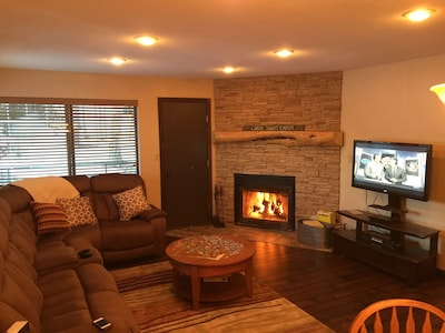 Family room with wood burning fireplace!