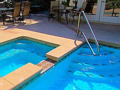 Large pool with jacuzzi that heats up in 30 min. Outdoor hot/cold shower