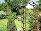 Small pretty & private garden with outdoor seating area, barbecue and pond.