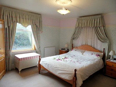 Main bedroom - King size bed, overlooking trees