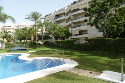 Playamar - 3rd Floor Flat with WiFi, Lift, Communal Pools and Gardens. 80sq