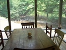Dine Overlooking the  Creek in Comfort on the Large Screened Porch.