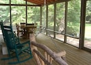 Creek winds around side & front of huge screened porch.