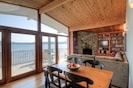 Stone fireplace and warm woodwork throughout .