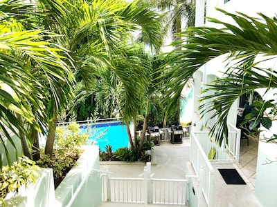 Easy access from car to door. Just a few steps through a tropical paradise.