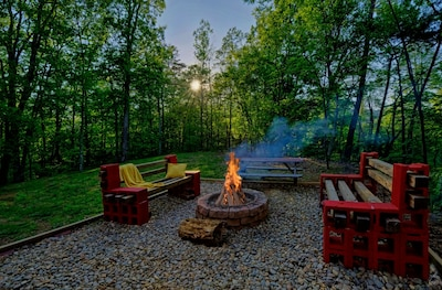Fire pit, spacious yard and plenty of parking are unique feautres of this cabin.