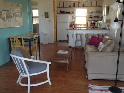 Living space, kitchen and door to the bathroom, far left