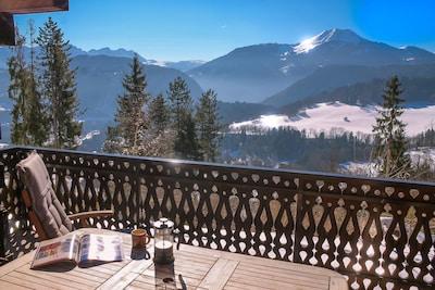 Balcony breakfast view, coffee and snow sparkle included. ChaletLeMoulin.com