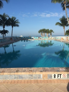 Swim in the large heated pool, look out to the Gulf.