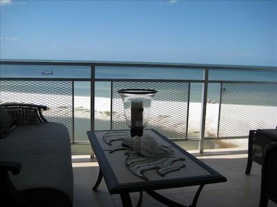 Watch dolphins swim by and view breathtaking sunsets from this gulf-front lanai