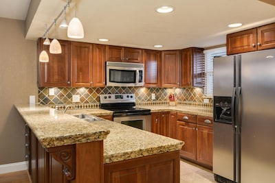Light and bright with breakfast bar lighting and under-cabinet lighting.