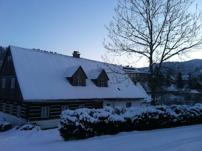 Cottage at dawn in winter