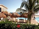 Palapas Poolside with Caribbean Ocean view