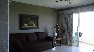 Living room with wrap around balcony
