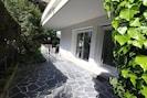 Extérieur : grande terrasse privative en angle Sud et Ouest