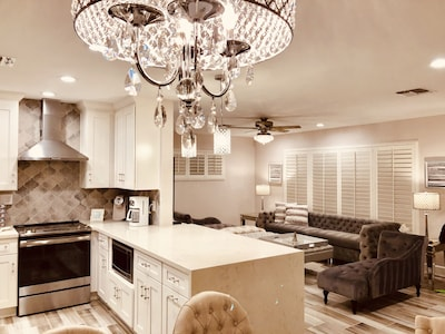 Huge waterfall quartz breakfast bar and open kitchen out into spacious living